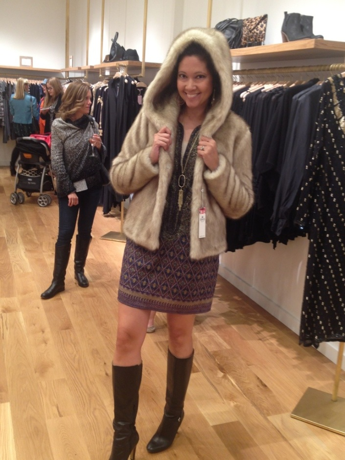 trying on faux fur for fun at Calypso St. Barth